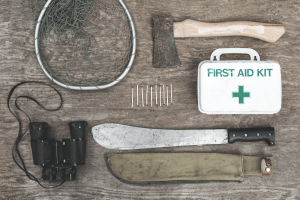 survival gear laid flat for prepper supply list