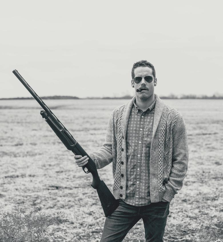 Man standing with shotgun